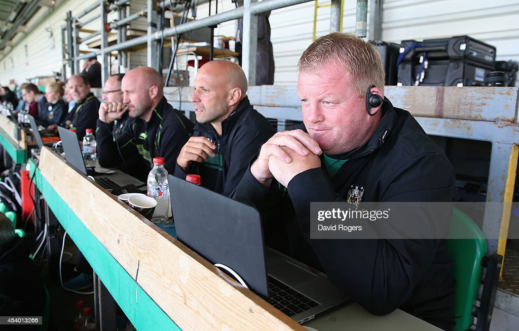 Dorian West, the Northampton Saints forwards coach watches the match with director of rugby, Jim Mallinder and Alex King, the backs coach during the pre season friendly match between Northampton Saints and Moseley at Franklin's Gardens on August 23, 2014 in Northampton, England.