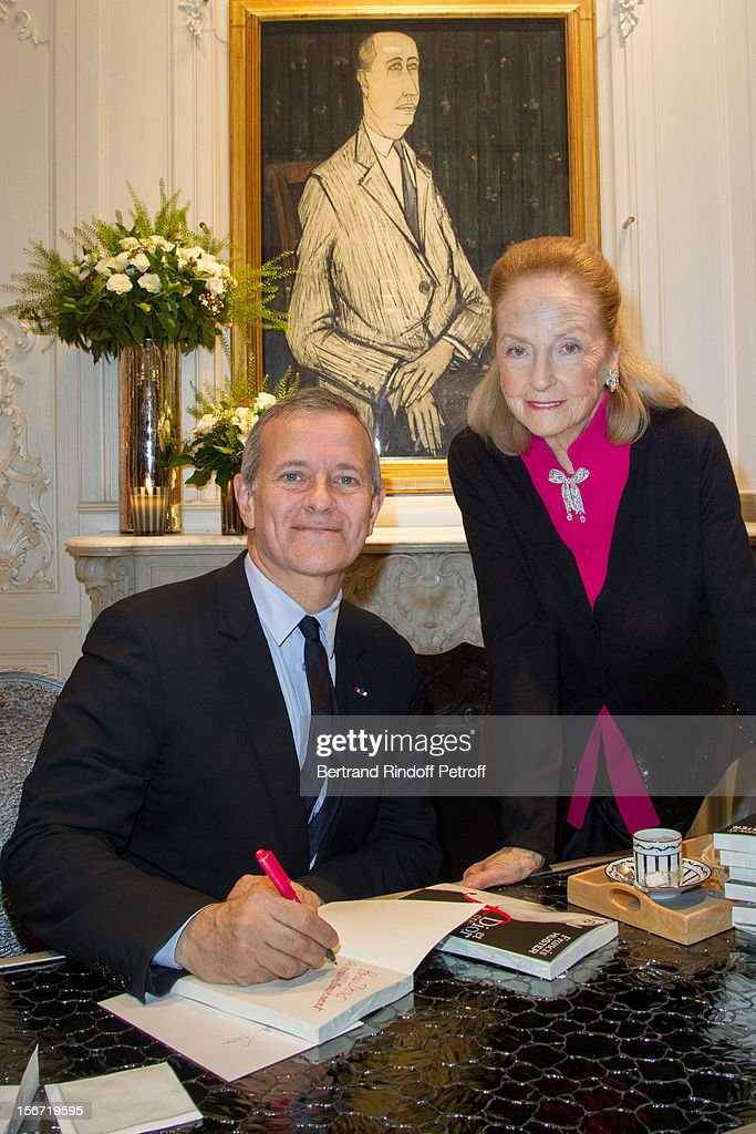 Doris Brynner (R) and Francis Huster attend the signing of Francis Huster's book 'And Dior Created Woman' at Dior Boutique on November 19, 2012 in Paris, France.