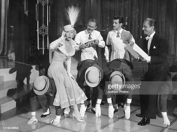 Doris Day Claude Dauphin and unidentified cast perform on stage in a scene from the film 'April In Paris' 1952