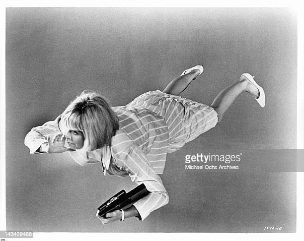 Doris Day floating in the air in a scene from the film 'The Glass Bottom Boat' 1966