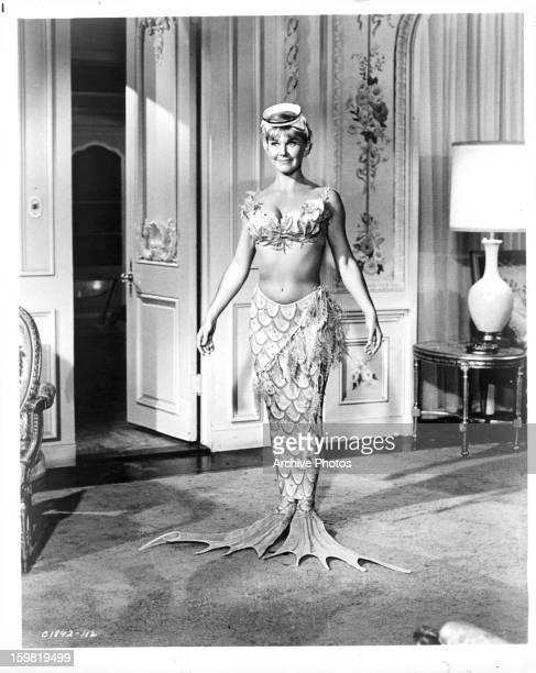 Doris Day in mermaid suit in a scene from the film 'The Glass Bottom Boat' 1966