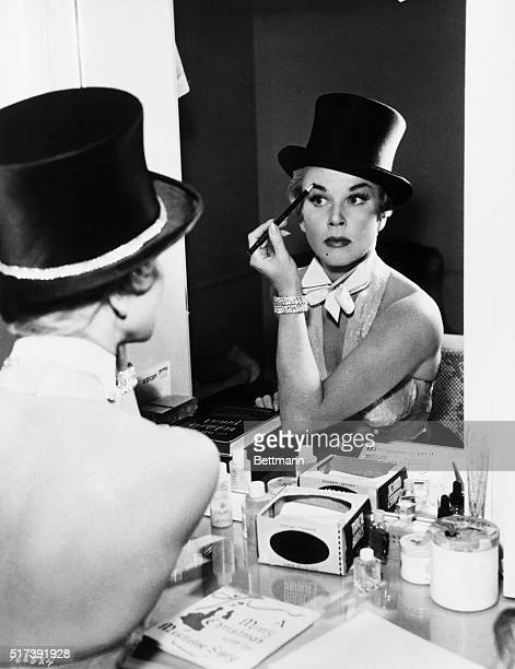 Doris Day puts the finishing touches on her eyebrows while making up for her new role as Ruth Etting glamorous singing star of the torrid 1920's in...