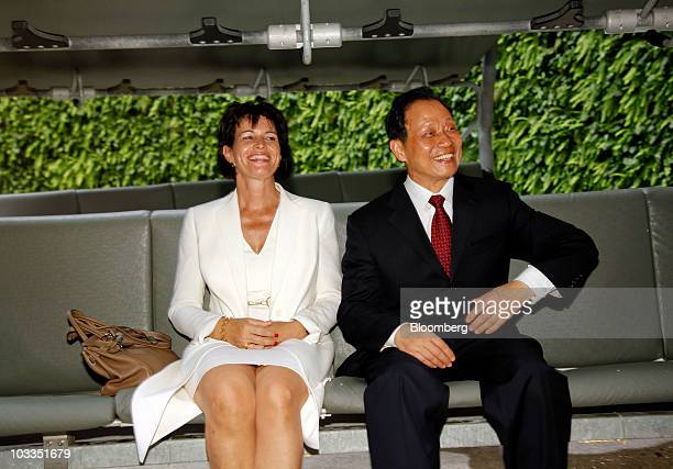 Doris Leuthard president of the Swiss Confederation left and Wu Dingfu chairman of the China Insurance Regulatory Commission pose for photos at the...