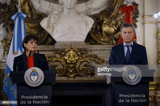 Doris Leuthard Switzerland's president left pauses while speaking while Mauricio Macri Argentina's president listens through a translation device...