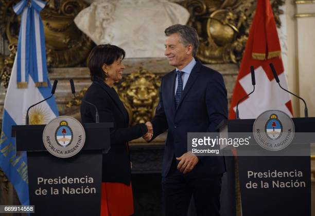 Doris Leuthard Switzerland's president left shakes hands with Mauricio Macri Argentina's president following a joint press conference at the...