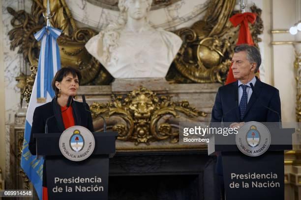 Doris Leuthard Switzerland's president left speaks while Mauricio Macri Argentina's president listens through a translation device during a joint...