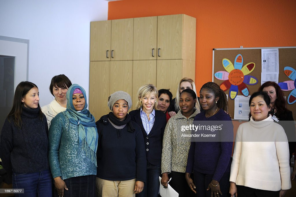 Doris Schroeder-Koepf, the wife of former German Chancellor Gerhard Schroeder, is seen posing with immigrants at a facility to help immigrants in Hanover, while campaigning in elections in the state of Lower Saxony on January 18, 2013 in Hanover, Germany. Schroeder-Koepf is running for office as a member of the German Social Democrats (SPD) to represent her local district in election scheduled for this Sunday. (Photo by Alexander Koerner/Getty Images) on January 18, 2013 in Hanover, Germany.