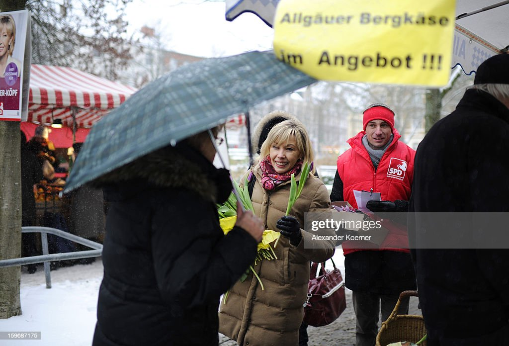 Doris Schroeder-Koepf, the wife of former German Chancellor Gerhard Schroeder, hands out flowers and speaks to passers-by while campaigning for elections in the state of Lower Saxony on January 18, 2013 in Hanover, Germany. Schroeder-Koepf is running for office as a member of the German Social Democrats (SPD) to represent her local district in election scheduled for this Sunday.