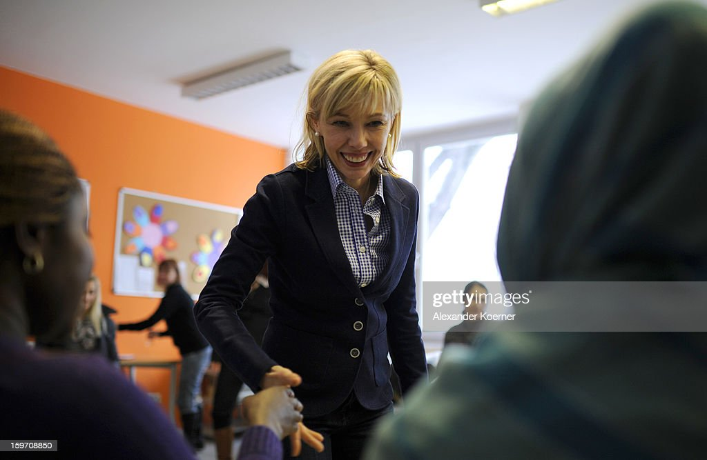 Doris Schroeder-Koepf, the wife of former German Chancellor Gerhard Schroeder, talks to immigrants at a facility to help immigrants in Hanover, while campaigning in elections in the state of Lower Saxony on January 18, 2013 in Hanover, Germany. Schroeder-Koepf is running for office as a member of the German Social Democrats (SPD) to represent her local district in election scheduled for this Sunday. (Photo by Alexander Koerner/Getty Images) on January 18, 2013 in Hanover, Germany.
