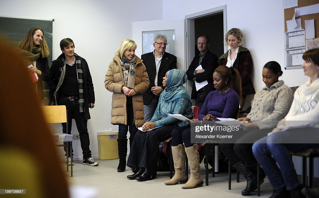 Doris Schroeder-Koepf, the wife of former German Chancellor Gerhard Schroeder, talks with immigrants at a facility to help immigrants in Hanover, while campaigning in elections in the state of Lower Saxony on January 18, 2013 in Hanover, Germany. Schroeder-Koepf is running for office as a member of the German Social Democrats (SPD) to represent her local district in election scheduled for this Sunday. (Photo by Alexander Koerner/Getty Images) on January 18, 2013 in Hanover, Germany.