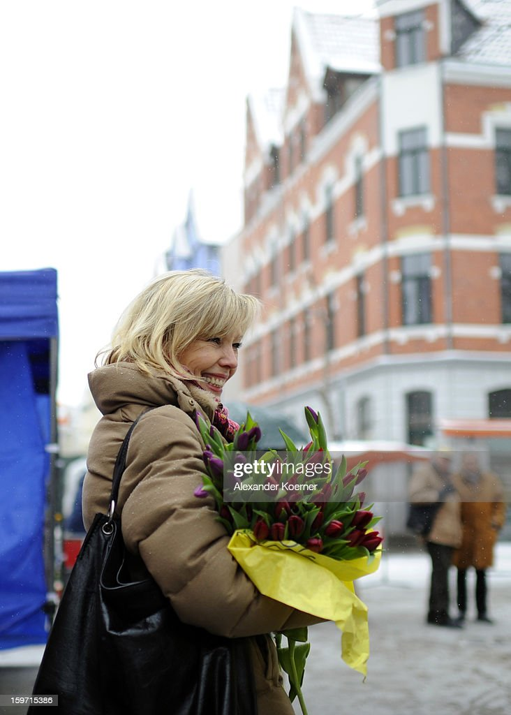 Doris Schroeder-Koepf, the wife of former German Chancellor Gerhard Schroeder, distributes flowers to supporters of the counterparty of the Christian Democratic Union (CDU) while campaigning in elections in the state of Lower Saxony on January 18, 2013 in Hanover, Germany. Schroeder-Koepf is running for office as a member of the German Social Democrats (SPD) to represent her local district in election scheduled for this Sunday.