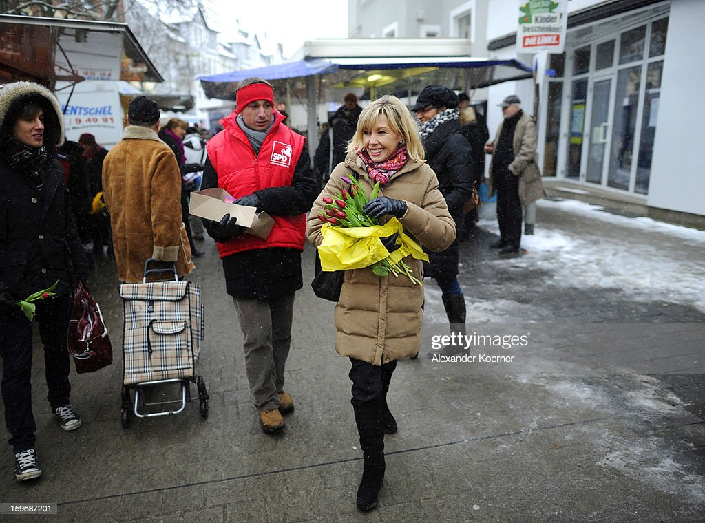 Doris Schroeder-Koepf, who is the wife of former German Chancellor Gerhard Schroeder, distributes flowers and speaks to passers-by while campaigning in elections in the state of Lower Saxony on January 18, 2013 in Hanover, Germany. Schroeder-Koepf is running for office as a member of the German Social Democrats (SPD) to represent her local district in election scheduled for this Sunday.