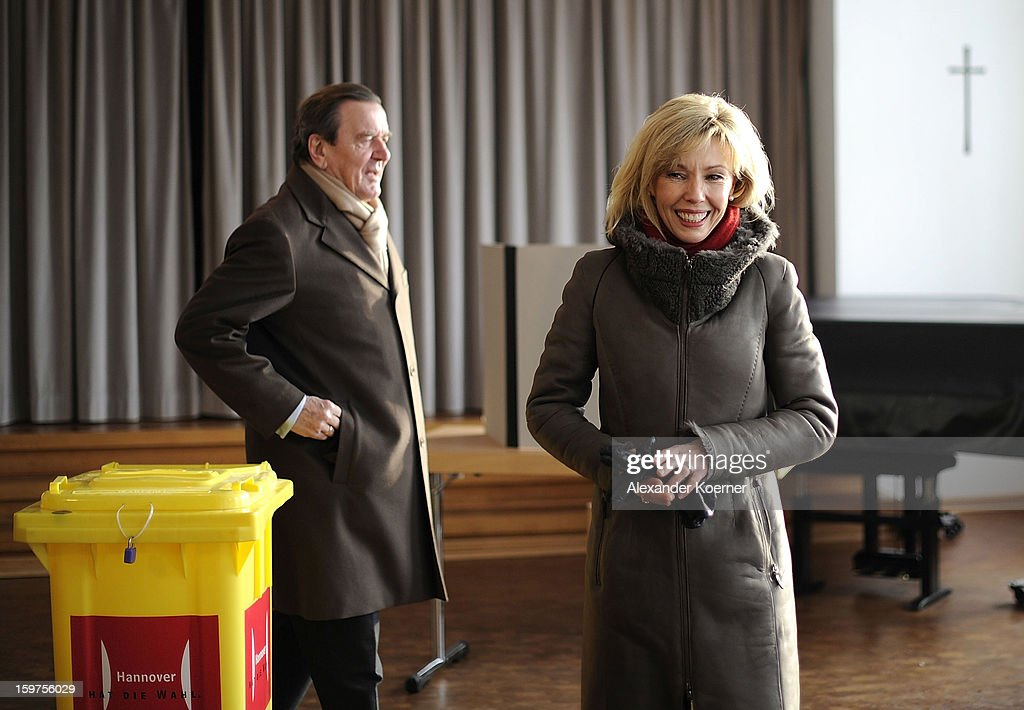 Doris Schroeder-Koepf, wife of former German Chancellor Gerhard Schroeder and local candidate of the German Social Democrats (SPD), arrives together with her husband to cast her ballot at a polling station in elections in Lower Saxony on January 20, 2013 in Hanover, Germany. The elections are being seen by many as a strong indicator for the general elections scheduled for later this year.