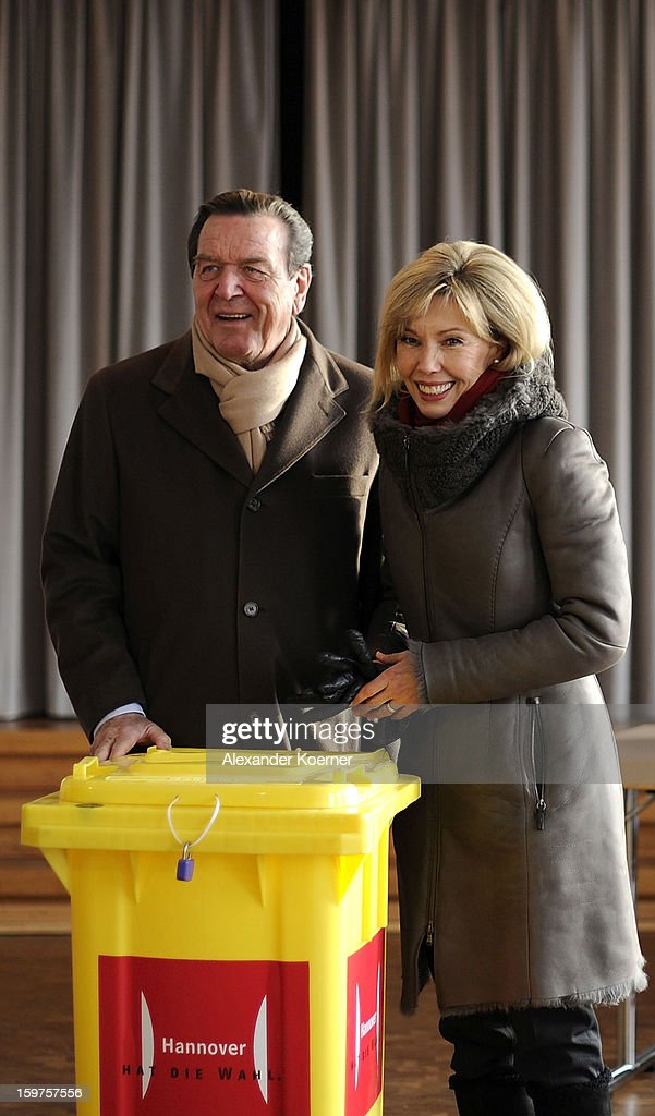 Doris Schroeder-Koepf, wife of former German Chancellor Gerhard Schroeder and local candidate of the German Social Democrats (SPD), her husband cast ballots at a polling station in elections in Lower Saxony on January 20, 2013 in Hanover, Germany. The elections are being seen by many as a strong indicator for the general elections scheduled for later this year.