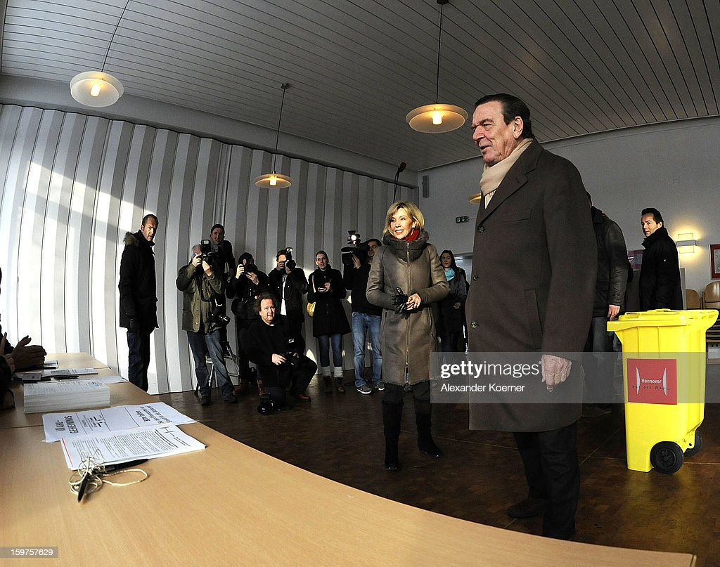 Doris Schroeder-Koepf, wife of former German Chancellor Gerhard Schroeder and local candidate of the German Social Democrats (SPD), her husband arrives to cast ballots at a polling station in elections in Lower Saxony on January 20, 2013 in Hanover, Germany. The elections are being seen by many as a strong indicator for the general elections scheduled for later this year.