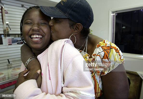 Doris Young and her daughter Emily live in a Los Angeles clothing store as they wait to receive Section 8 vouchers Thursday April 14 2005 Young and...
