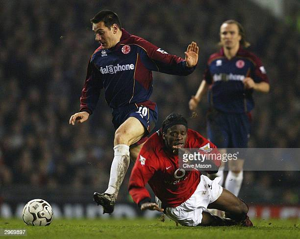 Doriva of Middlesbrough brings down Louis Saha of Manchester United during the FA Barclaycard Premiership match between Manchester United and...