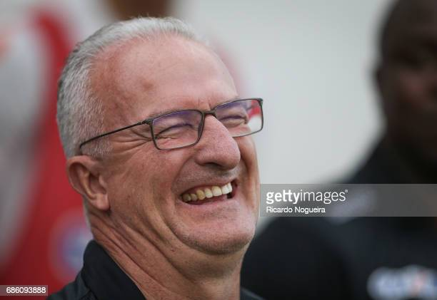 Dorival Junior headcoach of Santos smiles during the national anthem prior before the match between Santos and Coritiba as a part of Campeonato...