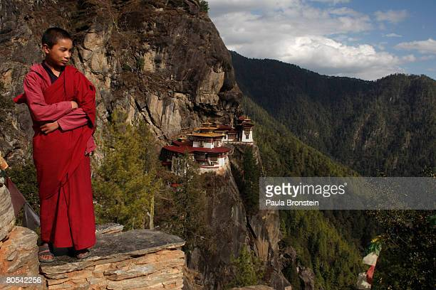 Dorji takes in the views after walking from the Taktshang monastery April 3 2008 outside of Paro Bhutan Dorji is one of a handful of monks living at...
