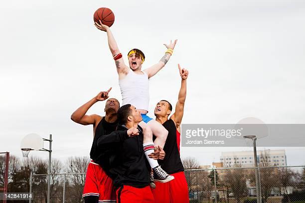Dorky man winning a basketball game..