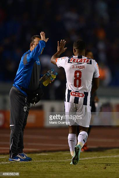 Dorlan Pabon of Monterrey celebrates with a member of his team's staff after scoring the only goal during a match between Monterrey and Chivas as...