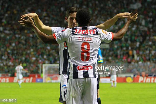 Dorlan Pabon of Monterrey celebrates with Bernardo Hernandez of Monterrey after scoring the third goal of his team during a match between Leon and...