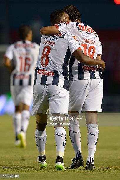 Dorlan Pabon of Monterrey celebrates with his teammate Neri Cardozo after scoring his team's first goal during a match between Monterrey and Morelia...