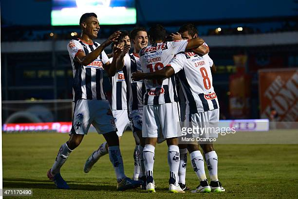 Dorlan Pabon of Monterrey celebrates with his teammates after scoring the first goal of his team during a match between Monterrey and Morelia as part...