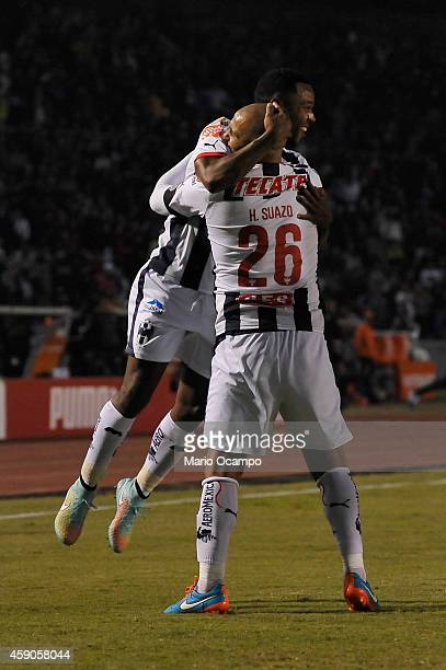 Dorlan Pabon of Monterrey celebrates with teammate Humberto 'Chupete' Suazo after scoring the opening goal during a match between Monterrey and...
