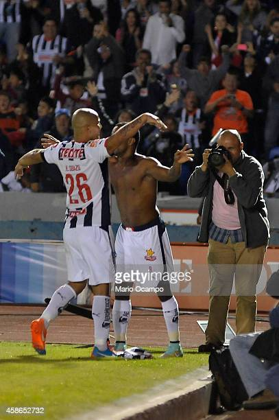 Dorlan Pabon of Monterrey celebrates with teammate Humberto Suazo after scoring his team's first goal during a match between Monterrey and Chiapas as...