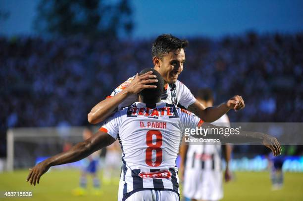 Dorlan Pabon of Monterrey celebrates with teammate Jesus Zavala after scoring a second goal during a match between Monterrey and Cruz Azul as part of...