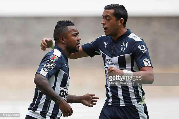 Dorlan Pabon of Monterrey celebrates with teammate Rogelio Funes Mori after scoring the first goal of his team during the 16th round match between...