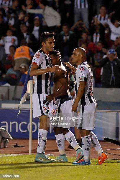 Dorlan Pabon of Monterrey celebrates with teammates after scoring his team's first goal during a match between Monterrey and Chiapas as part of 16th...