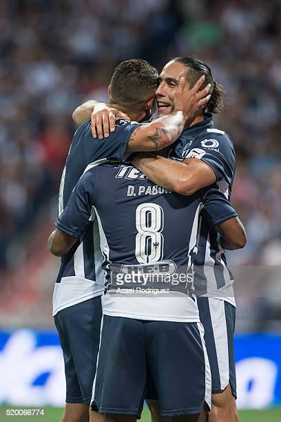 Dorlan Pabon of Monterrey celebrates with teammates after scoring his team's fourth goal during the 13th round match between Monterrey and Chiapas as...