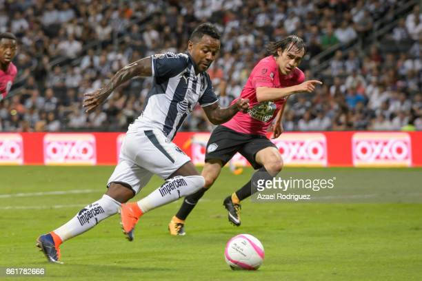 Dorlan Pabon of Monterrey drives the ball while is followed by Jose Martinez of Pachuca during the 13th round match between Monterrey and Pachuca as...
