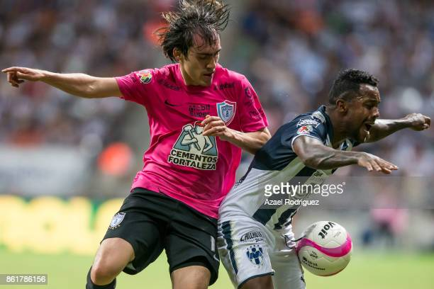 Dorlan Pabon of Monterrey fights for the ball with Jose Martinez of Pachuca during the 13th round match between Monterrey and Pachuca as part of the...