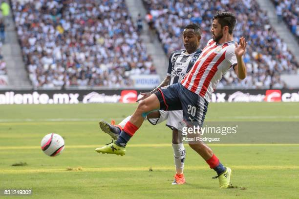 Dorlan Pabon of Monterrey fights for the ball with Rodolfo Pizarro of Chivas during the 4th round match between Monterrey and Chivas as part of the...