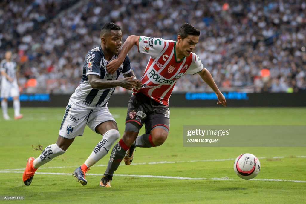 Dorlan Pabon of Monterrey fights for the ball with Xavier Baez of Necaxa during the 8th round match between Monterrey and Necaxa as part of the Torneo Apertura 2017 Liga MX at BBVA Bancomer Stadium on September 09, 2017 in Monterrey, Mexico.