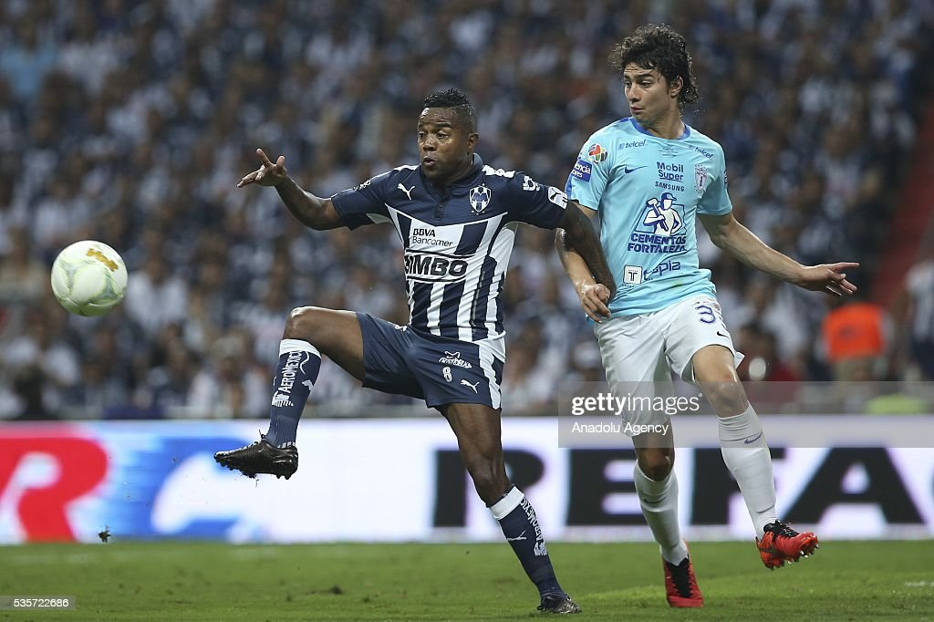 Dorlan Pabon (L) of Monterrey in action against John Medina (R) of Pachuca during the Final second leg match of the Clausura 2016 Liga MX between Monterrey and Pachuca, at BBVA Bancomer Stadium, in Monterrey, Mexico on May 29, 2016.