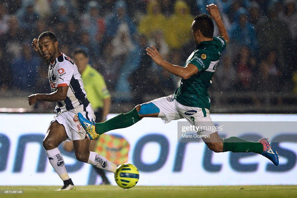 Dorlan Pabon of Monterrey kicks the ball as Edwin Hernandez of Leon tries to stop it during a match between Monterrey and Leon as part of 11th round Clausura 2015 Liga MX at Tecnologico Stadium on March 21, 2015 in Monterrey, Mexico.
