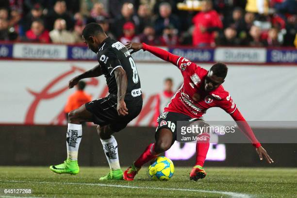 Dorlan Pabon of Monterrey loses the ball against Aviles Hurtado of Tijuana during the 8th round match between Tijuana and Monterrey as part of the...