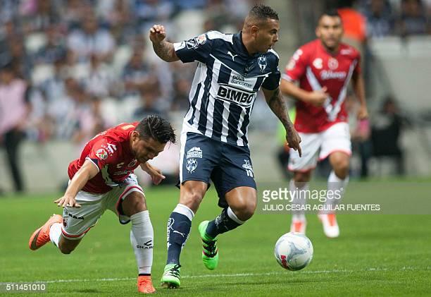 Dorlan Pabon of Monterrey vies for the ball with Jesus Paganoni of Veracruz during their Mexican Clausura 2016 tournament football match at the BBVA...