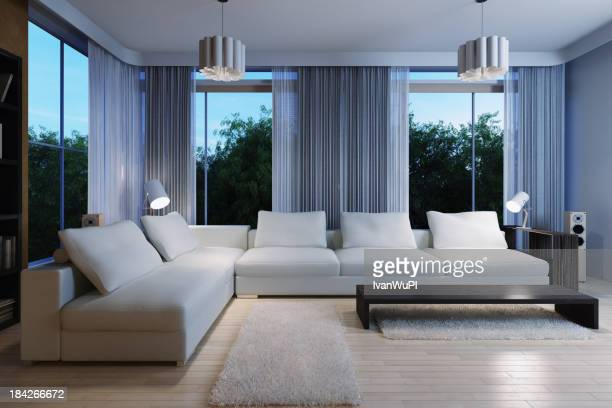 A dorm living room with a white sectional couch