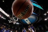 Doron Lamb of the Kentucky Wildcats looses the ball in front of Tyshawn Taylor of the Kansas Jayhawks in the first half in the National Championship...
