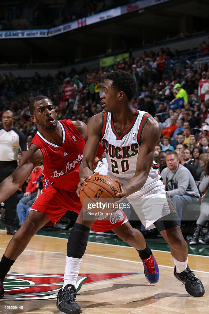 <a gi-track='captionPersonalityLinkClicked' href=/galleries/search?phrase=Doron+Lamb&family=editorial&specificpeople=7143029 ng-click='$event.stopPropagation()'>Doron Lamb</a> #20 of the Milwaukee Bucks looks to pass the ball around <a gi-track='captionPersonalityLinkClicked' href=/galleries/search?phrase=Chris+Paul&family=editorial&specificpeople=212762 ng-click='$event.stopPropagation()'>Chris Paul</a> #3 of the Los Angeles Clippers on December 15, 2012 at the BMO Harris Bradley Center in Milwaukee, Wisconsin.