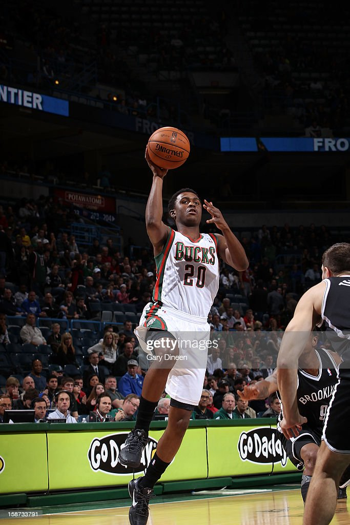 <a gi-track='captionPersonalityLinkClicked' href=/galleries/search?phrase=Doron+Lamb&family=editorial&specificpeople=7143029 ng-click='$event.stopPropagation()'>Doron Lamb</a> #20 of the Milwaukee Bucks shoots against <a gi-track='captionPersonalityLinkClicked' href=/galleries/search?phrase=MarShon+Brooks&family=editorial&specificpeople=4884862 ng-click='$event.stopPropagation()'>MarShon Brooks</a> #9 of the Brooklyn Nets during the NBA game on December 26, 2012 at the BMO Harris Bradley Center in Milwaukee, Wisconsin.