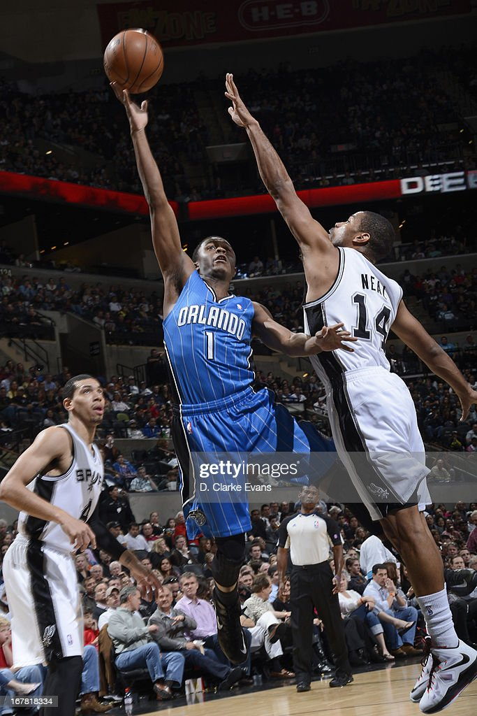 <a gi-track='captionPersonalityLinkClicked' href=/galleries/search?phrase=Doron+Lamb&family=editorial&specificpeople=7143029 ng-click='$event.stopPropagation()'>Doron Lamb</a> #1 of the Orlando Magic shoots against <a gi-track='captionPersonalityLinkClicked' href=/galleries/search?phrase=Gary+Neal&family=editorial&specificpeople=5085165 ng-click='$event.stopPropagation()'>Gary Neal</a> #14 of the San Antonio Spurs on April 3, 2013 at the AT&T Center in San Antonio, Texas.
