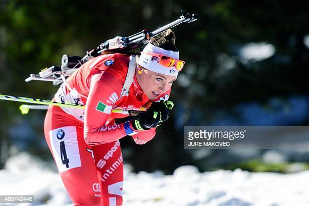 Dorothea Wierer of Italy competes in the women's 125 km mass start event during the IBU Biathlon World Cup in Pokljuka Slovenia on December 21 2014...