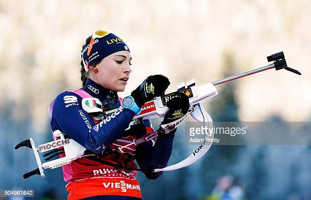 Dorothea Wierer of Italy loads her rifle on the shooting range during the Women's 15km biathlon race at the IBU Biathlon World Cup Ruhpolding on...