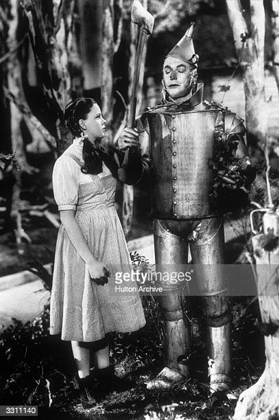 Dorothy and the Tin Man seen here in a still from the film 'The Wizard Of Oz' directed by Victor Fleming for MGM